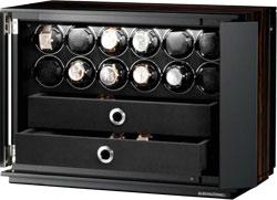 Шкатулка для наручных механических часов с автоподзаводом. Внешняя отделка шпоном макассара, внутри шкатулка отделана черным велюром. Два ящика для хранения 10 часов