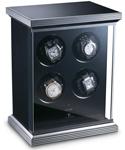 Строгая и современная шкатулка для четырех механических часов выполненная из стекла и алюминия