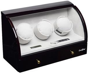 Механическая шкатулка для подзавода трех и хранения четырех ручных часов,внешнее покрытие из лака,внутренняя отделка из велюра,работает от сети