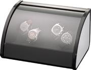 Шкатулка Elma для 4 часов, черная полированная, отделка алюминий. Обеспечивает все типы подзавода: по часовой стрелке, против часовой стрелки и переменное вращение. Держатели часов не повреждают часовые ремешки.