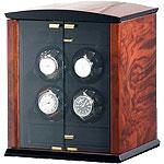 Шкатулка для подзавода механических часов Elma Corona 4. Материал корпуса шкатулки, изготовлен из корня ореха. Она представляет собой, миниатюрный шкафчик для ваших часов. Стеклянные дверцы позволяют наблюдать за работой шкатулки и вашими часами.